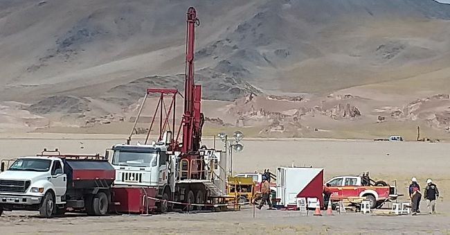 alaxys rig can be seen in the distance behind alans diamond drilling at andelas