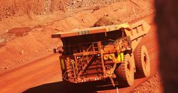 Iron ore, diversified miners higher